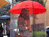 Using umbrella the asian way.